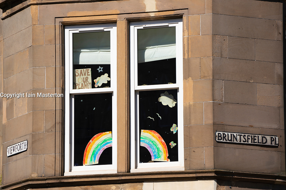 Rainbows in windows of flat in Bruntsfield district of Edinburgh during the coronavirus lockdown, Scotland, Uk