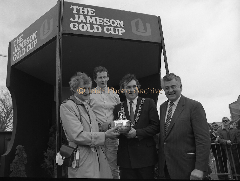 Irish Grand National At Fairyhouse.  (R54)..1987..20.04.1987..04.20.1987..20th April 1987..The Easter Racing Festival at Fairyhouse included the running of the Jameson sponsored Irish Grand National. Another featured race was the Jameson Gold Cup which was also run on Easter Monday...Mr Bertie Ahern TD, Minister for Labour and Lord Mayor of Dublin is pictured presenting the Jameson Irish Grand National Trophy to Mr Jimmy Glynn,Tuam, Co Galway owner of the winning horse 'Brittany Boy'. Included in the image are Mr Richard Burrows,Group managing Director,Irish Distillers and Mr Tom Taffe the winning jockey, Jameson's, Irish, Whiskey, jameson,