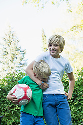 Young boy having his brother in a headlock