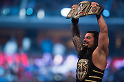 Roman Reigns celebrates after defeating Triple H and becoming the WWE World Heavyweight Champion during WrestleMania on April 3, 2016 in Arlington, Texas.