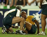 Photo: Richard Lane.<br />New Zealand v Australia. Semi-Final, at the Telstra Stadium, Sydney. RWC 2003. 15/11/2003. <br />George Gregan goes down injured on the final whistle.
