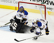 Dallas Stars center Ryan Garbutt (40) slides into St. Louis Blues goalie Jaroslav Halak (41) after a shot attempt in the second period at the American Airlines Center in Dallas, Texas, on January 26, 2013.  (Stan Olszewski/The Dallas Morning News)