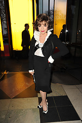 JOAN COLLINS at the opening of the Victoria & Albert Museum's latest exhibition 'Grace Kelly: Style Icon' opened by His Serene Highness Prince Albert of Monaco at the V&A on 15th April 2010.