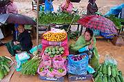 Food stalls in market in mountain town of Phou Khoun, Laos.