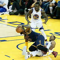 01 June 2017: Cleveland Cavaliers forward LeBron James (23) is fouled by Golden State Warriors forward Andre Iguodala (9) in front of Golden State Warriors forward Draymond Green (23) during the Golden State Warriors 113-90 victory over the Cleveland Cavaliers, in game 1 of the 2017 NBA Finals, at the Oracle Arena, Oakland, California, USA.