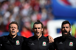 Chris Gunter of Wales, Gareth Bale of Wales and Joe Ledley of Wales sing the national anthem  - Mandatory by-line: Joe Meredith/JMP - 25/06/2016 - FOOTBALL - Parc des Princes - Paris, France - Wales v Northern Ireland - UEFA European Championship Round of 16