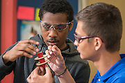 "Members of the Madison High School rocket club team, ""Sensation Station,"" work on a new rocket, April 15, 2016. The team qualified to compete in the national finals of the Team America Rocketry Challenge (TARC), which will be held outside of Washington, D.C. on the weekend of May 13-15, 2016.<br /> <br /> TARC is the world's largest student rocket contest and a key piece of the aerospace and defense industry's strategy to build a stronger U.S. workforce in science, technology, engineering, and mathematics (STEM). It gives students the opportunity to apply their math and science skills to a real-world project outside the classroom. This year's qualifying challenge was to design, build, and fly a rocket that has a maximum altitude of 850 feet, returns to the ground within 45 seconds, and carries two eggs, which have to survive the flight unscathed. 789 teams from all 50 states entered this year's contest. The Madison High school team, as the only team within the Houston Independent School District, emerged from the qualifying round as one of the 100 best teams that will go on to compete for more than $100,000 in scholarships and the title of National Champion.<br /> <br /> The members of the Madison High School team, mentored by AP Physics teacher Dr. Maqsuda Afroz, are Dennis Ngyuen, Cristhian Benavides, Justin King, Kelon Tidwell, and Cristian Ramirez."