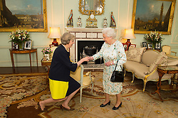 Embargoed to 0001 Wednesday December 28 File photo dated 13/07/16 of Queen Elizabeth II welcoming Theresa May at the start of an audience in Buckingham Palace, London, where she invited the former Home Secretary to become Prime Minister and form a new government.