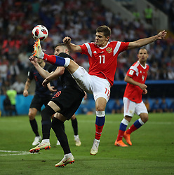 SOCHI, July 7, 2018  Roman Zobnin (R front) of Russia vies with Ante Rebic (L front) of Croatia during the 2018 FIFA World Cup quarter-final match between Russia and Croatia in Sochi, Russia, July 7, 2018. (Credit Image: © Wu Zhuang/Xinhua via ZUMA Wire)