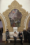 Moscow, Russia, 21/01/2011..The Moscow Metro underground transport system, renowned for its' spectacular Soviet architecture: passengers, mosaics and murals at Kievsky station.