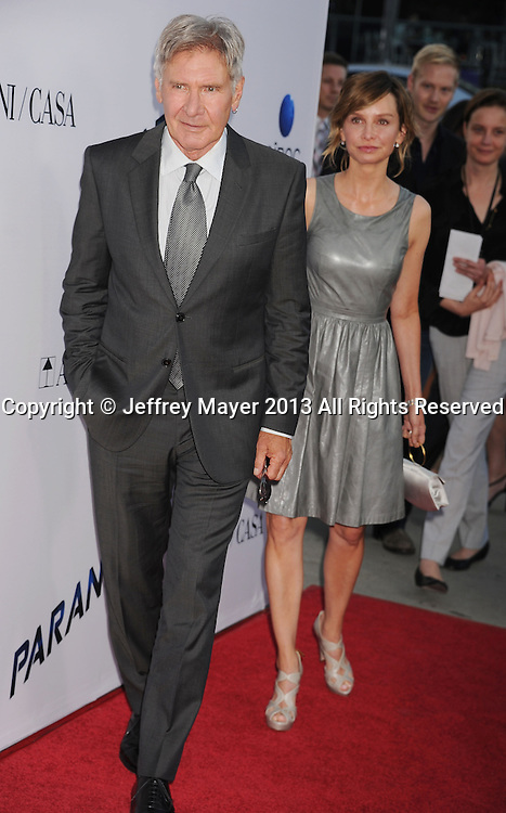 LOS ANGELES, CA- AUGUST 08: Actors Harrison Ford and Calista Flockhart arrive at the 'Paranoia' - Los Angeles Premiere at DGA Theater on August 8, 2013 in Los Angeles, California.