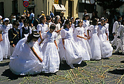 Boys and girls dressed up as part of celebrations for the  Feast of Corpus Christi, Ronda, Andalucia, Spain