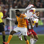 Bradley Wright-Phillips, New York Red Bulls, is challenged by Warren Creavalle, Houston Dynamo, during the New York Red Bulls V Houston Dynamo , Major League Soccer second leg of the Eastern Conference Semifinals match at Red Bull Arena, Harrison, New Jersey. USA. 6th November 2013. Photo Tim Clayton