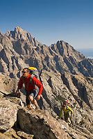 A young couple climbs the east ridge of Buck Mountain in Grand Teton National Park, Jackson Hole, Wyoming.