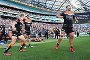 The Tigers bench celebrate after the final whistle sounds. Wests Tigers v Sydney Roosters. NRL Rugby League. ANZ Stadium, Sydney, Australia. 10th March 2018. Copyright Photo: David Neilson / www.photosport.nz