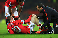 Wayne Rooney of Manchester United holds his knee after falling into the advertising boards - Manchester United vs. Hull City - Barclay's Premier League - Old Trafford - Manchester - 29/11/2014 Pic Philip Oldham/Sportimage