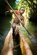 Boy on canoe in the mangroves, Mclaren Harbour, Tufi, Cape Nelson, Oro Province, Papua New Guinea