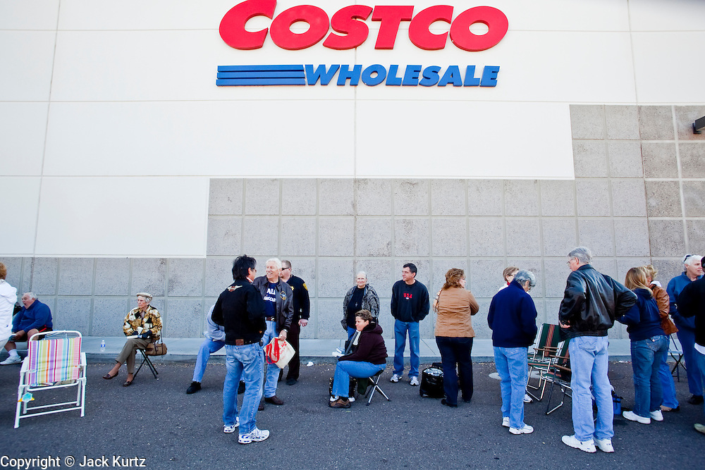 """Dec. 1, 2009 -- TEMPE, AZ: People wait in line at the Costco in Tempe, AZ, to get Sarah Palin's autograph in her book, """"Going Rogue."""" Former Alaska Governor Sarah Palin signed copies of her book, """"Going Rogue"""" at a Costco in Tempe, AZ, Tuesday. More than one thousand people showed up for the signing. About 150 of them spent the night at the store. Palin did not make any comments or speak to the address during her appearance in Tempe.  Photo by Jack Kurtz"""