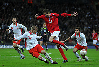 Photo: Tony Oudot/Richard Lane Photography. <br /> England v Switzerland. International Friendly. 06/02/2008. <br /> Peter Crouch of England goes past Stephane Grichting of Switzerland