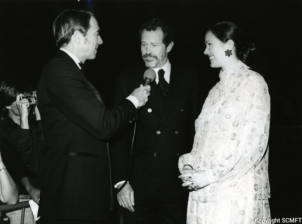 1979 Army Archer interviews Warren Oates and his wife at the premiere of Hurricane at Mann's Chinese Theater