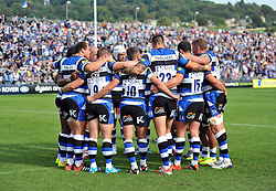 The Bath team huddle together - Photo mandatory by-line: Patrick Khachfe/JMP - Mobile: 07966 386802 13/09/2014 - SPORT - RUGBY UNION - Bath - The Recreation Ground - Bath Rugby v London Welsh - Aviva Premiership