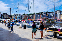 Tourists by the harbour in Honfleur, Normandy, France