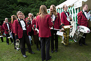 The Hardraw Scaur Brass Band Festival. Members of Elland band prepare for their performance. Organised by the Yorkshire and Humberside Brass Band Association, the competition is Britain's second oldest outdoor contest and takes place annually in Hardraw Scar in Wensleydale, North Yorkshire, England, UK. The area, a natural amphitheatre, attracts bands from all over the North of England and is a popular event amongst players and audiences alike.