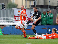 Photo: Paul Greenwood.<br />Blackpool v Bristol City. Coca Cola Championship. 18/08/2007.<br />Bristol's Lee Trundle (C) shoots on goal despite the challenge of Kaspars Gorkss