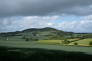 Rolling landscape view of agricultural fields in the hills on 23rd May 2020 near Martley, United Kingdom. Martley is a village and civil parish in the Malvern Hills district of the English county of Worcestershire.