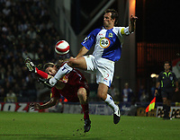 Photo: Paul Thomas.<br /> Blackburn Rovers v SV Red Bell. UEFA Cup. 28/09/2006.<br /> <br /> Lucas Neill (R) of Blackburn gets to the ball before Ezequiel Alejo Carboni.