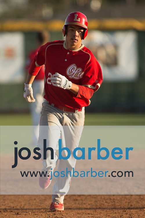 Orange Lutheran's Nathan Flores (29) runs the bases after hitting a grand slam during a Trinity League game at Mater Dei High School on Friday, May 1, 2015 in Santa Ana, Calif. (Photo/Josh Barber)