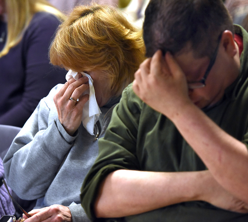 Mara Lavitt -- Special to the Hartford Courant<br /> February 14, 2016, Glastonbury<br /> Amyotrophic Lateral Sclerosis (ALS) forced Nancy Butler of Marlborough to step down as pastor of the Riverfront Family Church in Glastonbury during the Sunday service. Carol Robinson of Glastonbury, left, and Ben Dubow of South Windsor during the service. Dubow became a co-pastor at this service.