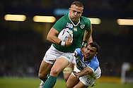 Ireland's Ian Madigan goes past Argentina's Martin Landajo. Rugby World Cup 2015 quarter-final match, Ireland v Argentina at the Millennium Stadium in Cardiff, South Wales  on Sunday 18th October 2015.<br /> pic by  Andrew Orchard, Andrew Orchard sports photography.