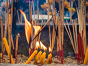 22 AUGUST 2015 - BANGKOK, THAILAND: Candles and incense burn in Erawan Shrine Saturday. Erawan Shrine in Bangkok reopened Wednesday, August 19, after more than 20 people were killed and more than 100 injured in a bombing at the shrine Monday, August 17, 2015. The shrine is a popular tourist attraction in the center of Bangkok's high end shopping district and is an important religious site for Thais. No one has claimed responsibility for the bombing.             PHOTO BY JACK KURTZ
