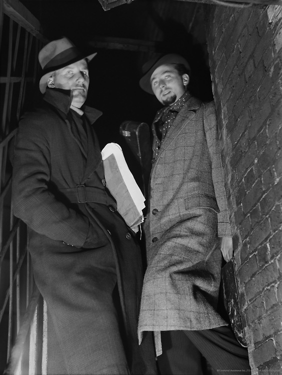 """Two Men in a Doorway Wearing Hats and Overcoats, """"Bohemia"""" Series, London, 1935"""