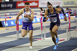 Great Britain's Andy Pozzi (left) and France's Pascal Martinot-Lagard during the Men's 60m Hurdles Final during day three of the European Indoor Athletics Championships at the Emirates Arena, Glasgow.