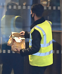 © Licensed to London News Pictures. 25/02/2021. London, UK.  A McDonald's breakfast is delivered to the Radisson hotel near Heathrow Airport. New quarantine measures were introduced for travellers form red list countries, who are required to isolate for ten days in a hotel at a cost of £1,750 per person. Photo credit: Ben Cawthra/LNP