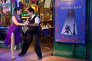 Tango dancers in La Boca dancing outside a restaurant with tango show. .