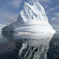 'The Crown' – Arrowsmith Peninsula, South of Antarctic Circle<br /> This pinnacled domed iceberg changed shapes with each vantage point as we circumnavigated it in our zodiac.  This view provided     the most spectacular angle for the crown.
