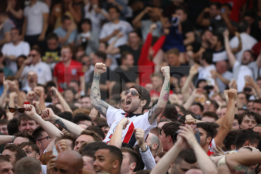 © Licensed to London News Pictures . 11/07/2018. Manchester, UK. England go one up. Football fans watch England play against Croatia in the World Cup semi finals, on a big screen at Castlefield Bowl in Manchester City Centre . Until today , Manchester had been the largest city in England not to be showing World Cup matches to the public on a big screen . Photo credit: Joel Goodman/LNP