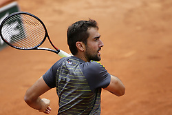May 29, 2019 - Paris, France - Croatia's Marin Cilic returns the ball to Bulgaria's Grigor Dimitrov during their men's singles second round match on day four of The Roland Garros 2019 French Open tennis tournament in Paris on May 29, 2019. (Credit Image: © Ibrahim Ezzat/NurPhoto via ZUMA Press)