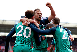 Tottenham Hotspur's Harry Kane (centre) celebrates scoring his side's first goal of the game during the Premier League match at St Mary's Stadium, Southampton.
