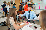 Teacher Development Specialist Chris Puente assists Erica Harris in her freshman English class at Carnegie Vanguard High School, May 10, 2013.