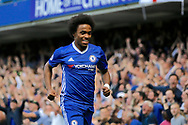 Chelsea Midfielder Willian (22) celebrates his goal (score 1-1) during the Premier League match between Chelsea and Sunderland at Stamford Bridge, London, England on 21 May 2017. Photo by Andy Walter.