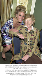 Left to right, milliner COSMO JENKS and her mother MRS ROSEMARY JENKS,  at a fashion show in London on 15th April 2002.OYY 4