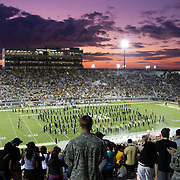 Members of the U.S. Military football cheer in remembrance of 9/11, during an NCAA football game between the Boston College Eagles and the UCF Knights at Bright House Networks Stadium on Saturday, September 10, 2011 in Orlando, Florida. (AP Photo/Alex Menendez)