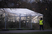 A COVID-19 Response worker walks past the temporary facility serving as an asymptomatic COVID-19 testing centre is located in Brockwell Park in Lambeth, during the third pandemic lockdown, on 21st January 2021, in London, England. Government ministers are to discuss proposals to pay anyone in England who tests positive for Covid-19 £500 to self-isolate. Many workers are currently strugling financially because low paid workers cannot afford to self-isolate.