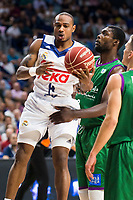 Real Madrid's player Dontaye Draper and Unicaja Malaga's player Viny Okouo during match of Liga Endesa at Barclaycard Center in Madrid. September 30, Spain. 2016. (ALTERPHOTOS/BorjaB.Hojas)