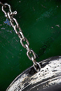 Commercial fishing boat anchor of a green hull ship