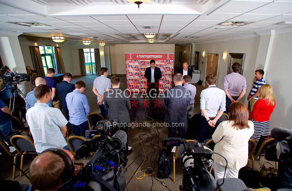 CARDIFF, WALES - Thursday, May 25, 2017: Wales' manager Chris Coleman stands to observe a minute's silence for the victims of the Manchester Arena bombing at the Vale Resort during a press conference to announce his squad ahead of the 2018 FIFA World Cup Qualifying Group D match against Serbia. (Pic by David Rawcliffe/Propaganda)